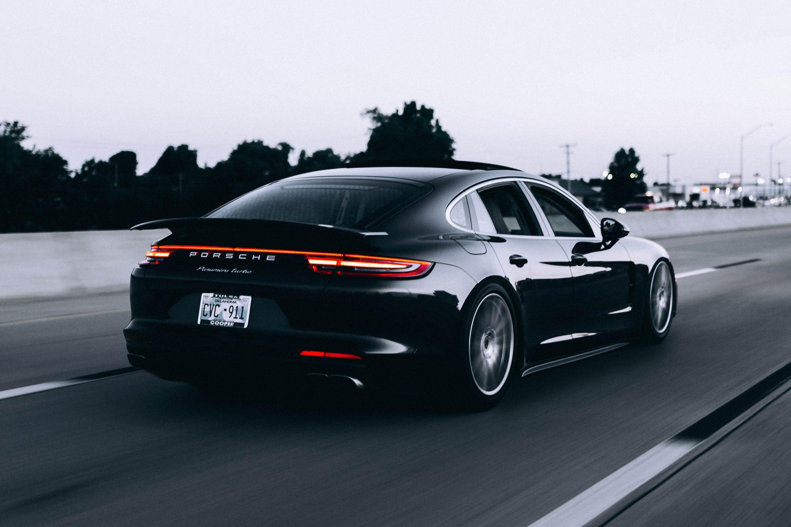 wallpaper Running black Porsche sedan