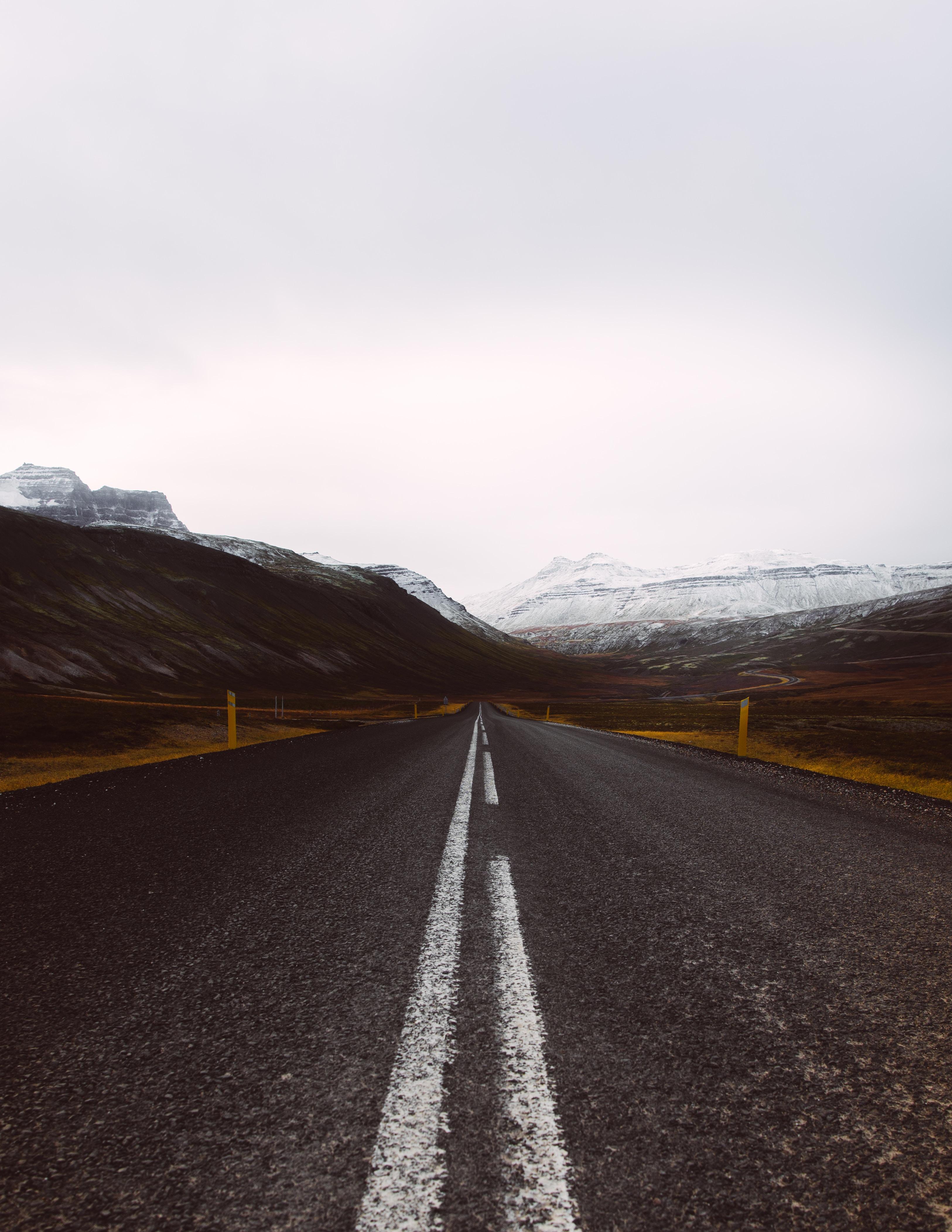wallpaper Gray asphalt road under cloudy sky