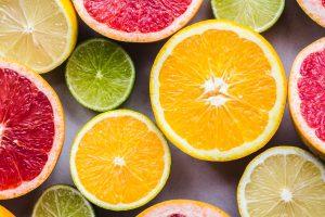Sliced pomegranate, lime, and lemon