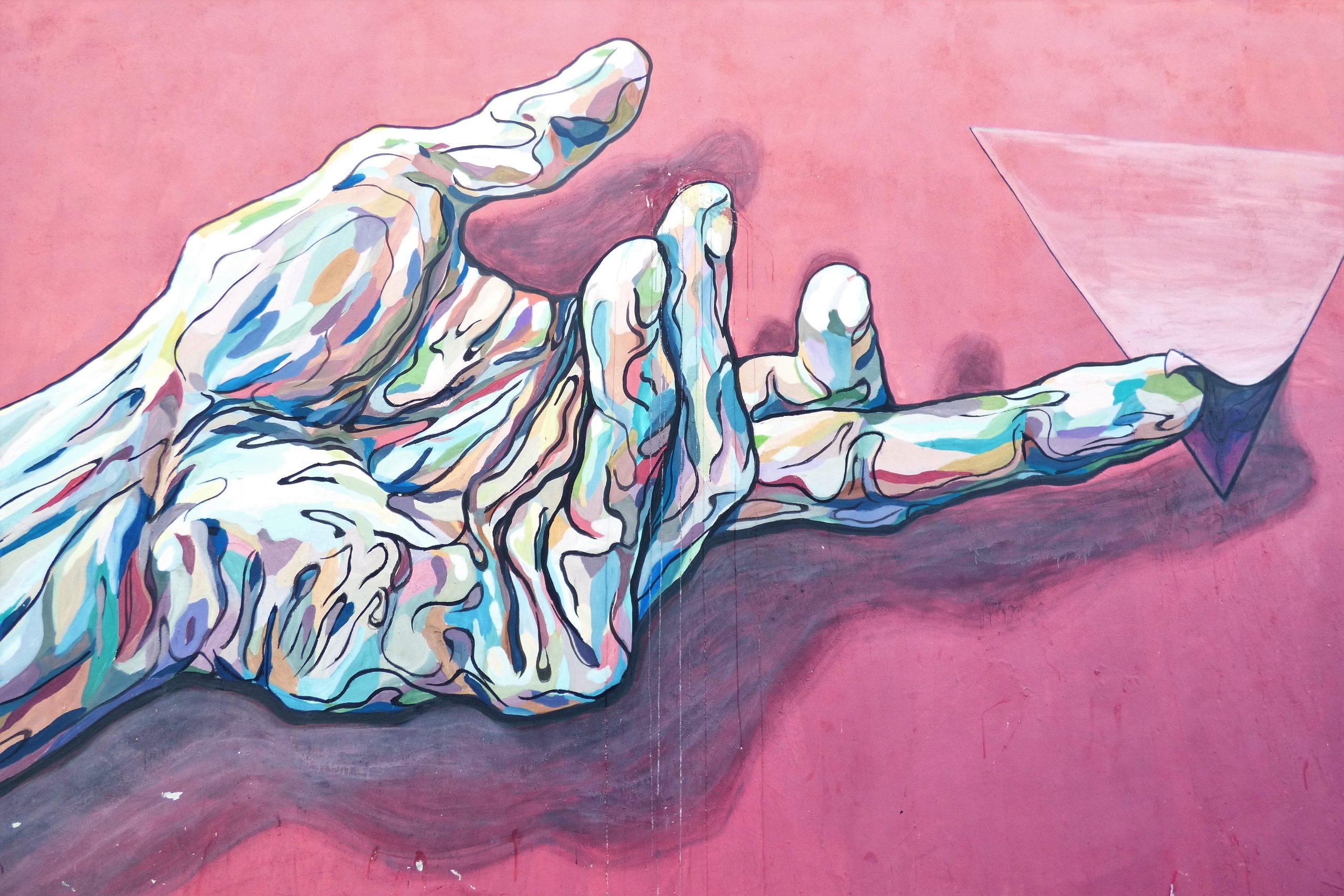 wallpaper Hand holding pyramid painting