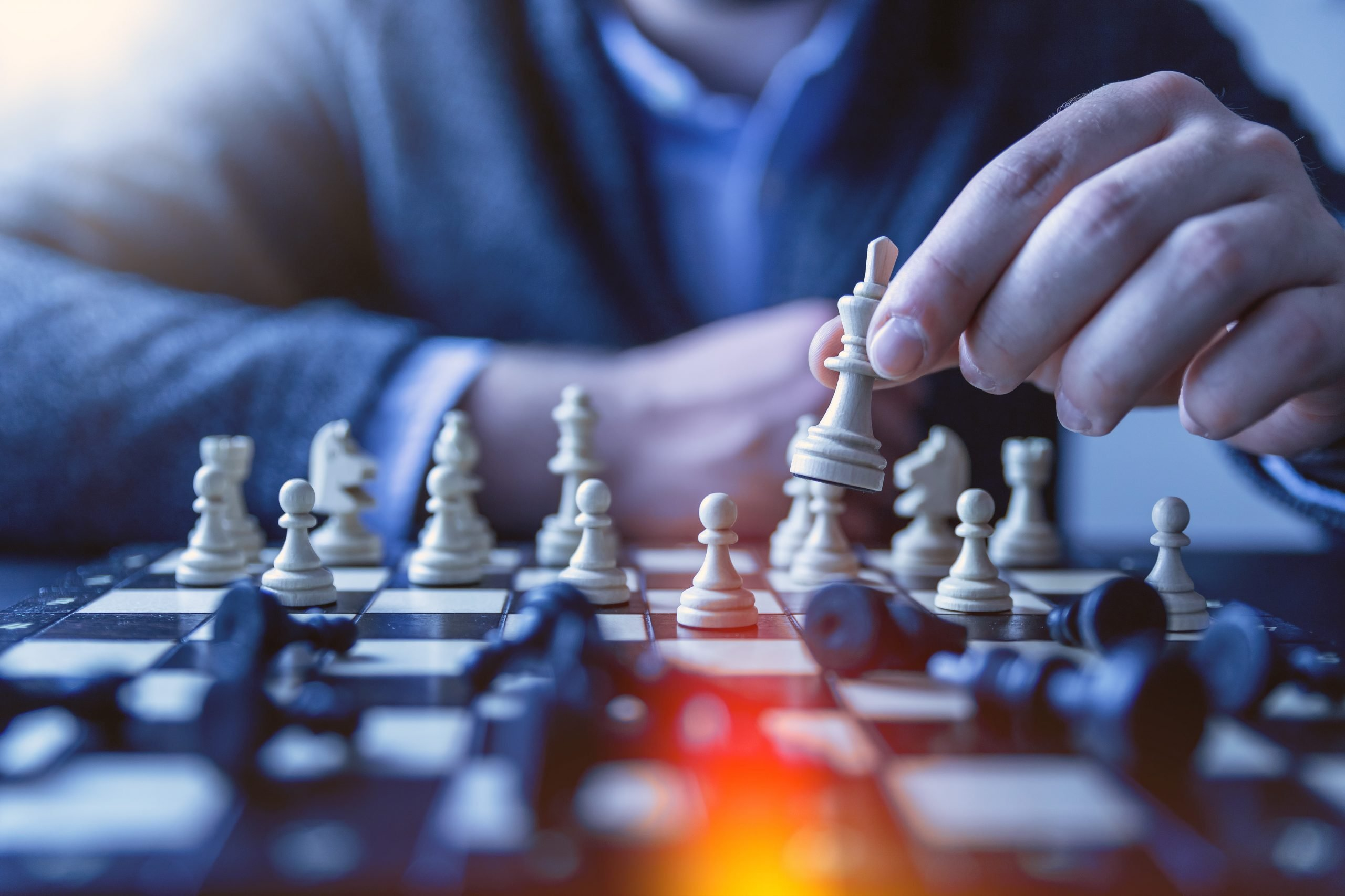 wallpaper Depth of field photography of man playing chess