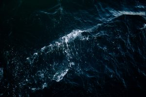 High-angle photo of the sea with waves