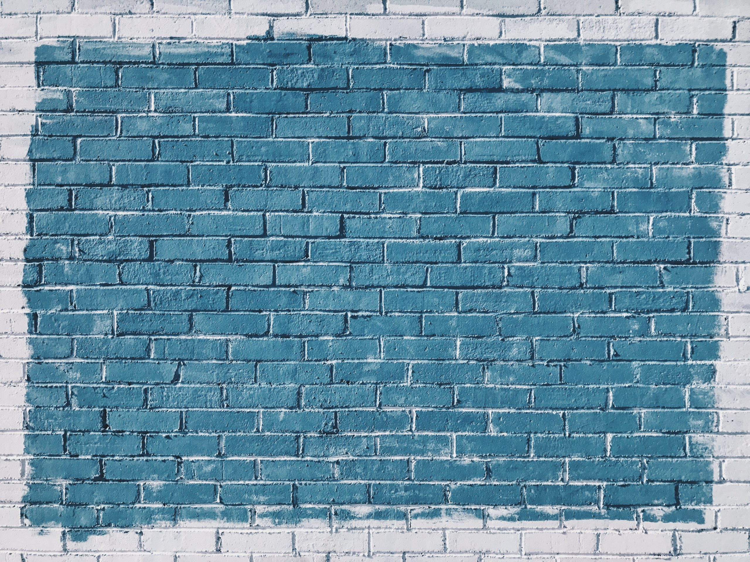wallpaper Gray concrete bricks painted in blue