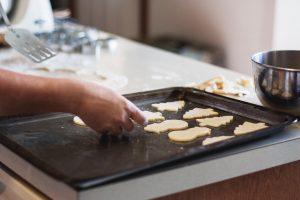 Cookies on baking sheet inside kitchen