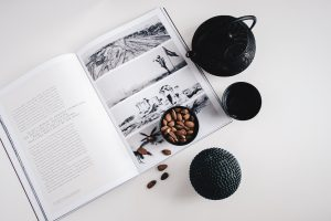 Teapot and teacup on book