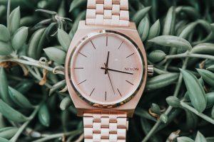 Rose gold colored Nixon analog watch wallpaper