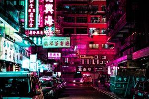 Vehicles park on neon roadway