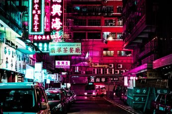 Vehicles park on neon roadway