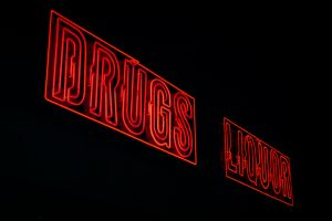 Red drugs liquor neon signages