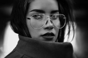 Woman wearing coat and eyeglasses