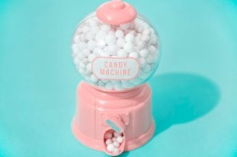 White and pink candy machine dispenser