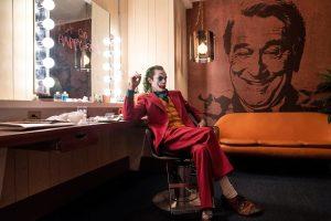 Joker Robert DeNiro happy face Joaquin Phoenix couch makeup wallpaper