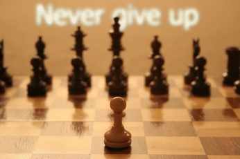 Wallpaper brown pawn chess piece, quote, typography, motivational, depth of field