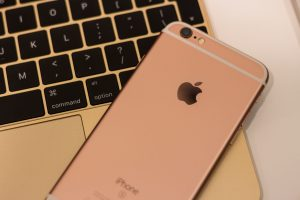 Wallpaper rose gold iPhone 6s on top of 12-inch gold MacBook, apple, macbook 12