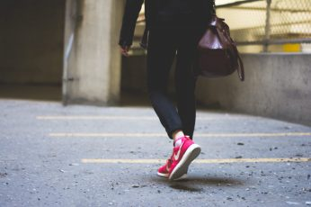Wallpaper person wearing Nike running shoes walking along the path, woman walking on road near fence