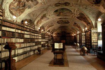 Library interior, books, shelves, globes, Prague, Czech Republic wallpaper