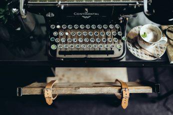 Black vintage typewriter, keyboard, old, retro, cyrylic, antique wallpaper