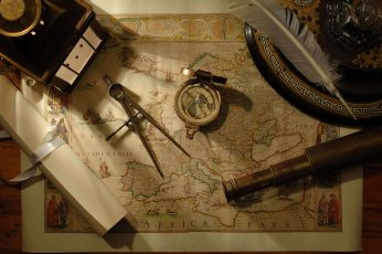 vintage European map, compass, tools, feathers, scrolls, telescope wallpaper