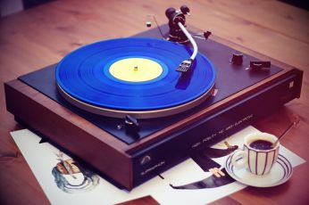 Black, brown, and blue vinyl record player, vintage wallpaper, coffee, music