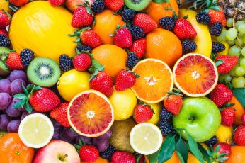 Assorted fruit lot, food, strawberries, blood orange, lemons wallpaper