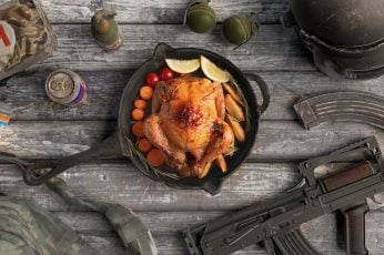 Black cast iron skillet and black assault rifle, Chicken, still life wallpaper