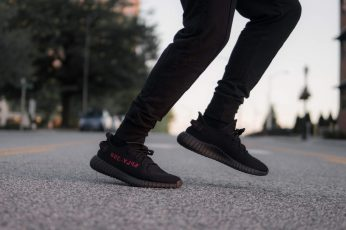 Black-and-red adidas Yeezy Boost 350 v2 sneakers wallpaper