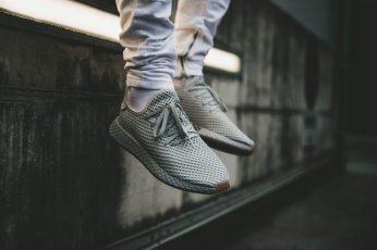 Boost Season wallpaper, closeup photo of person wearing pair of gray running shoes