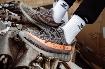 Beluga Adidas Yeezy Boost 350 V2 shoes wallpaper, person wearing orange Yeezy Boost 350 v2 sneakers