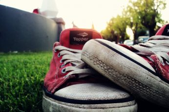 Pair of red-and-white Topper low-top sneakers wallpaper, shoes, grass, focus on foreground