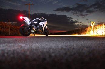 Photo of white sports bike on roadway during nightime wallpaper, Honda