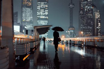 Black umbrella wallpaper, person holding umbrella walking on street during nightime