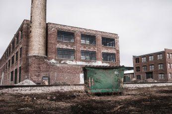 Green garbage bin near building at daytime wallpaper, urban, lazy, factory