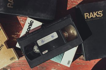 Black VHS tape wallpaper, text, communication, western script, technology