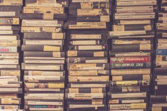 VHS tape lot wallpaper, stack of assorted-title cases, video, vintage, film