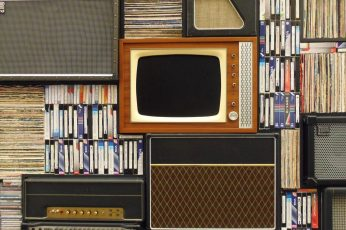 Assorted antique appliance and cassette tapes wallpaper, old tv, records