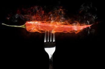 Fire food wallpaper, chilli peppers, black background, studio shot, fork
