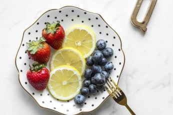 Blueberries wallpaper, strawberries, and lime slices on plate, fruit