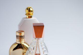Three fragrance bottles wallpaper, perfume, cologne, pink, girly, feminine