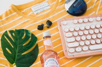 Bottle and keyboard on striped crew-neck shirt wallpaper, flatlay, autumn