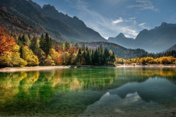Body of water, calm body of water surrounded with trees and mountains