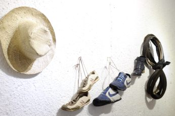 Indonesia, suar art space, white wall, sneakers, hanging, hat