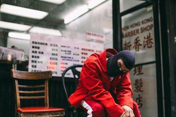 Man in a black mask, man wearing red jacket, pants