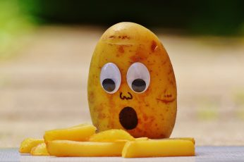 Funny potato wallpaper with googly eyes and French fries, potatoes, mourning