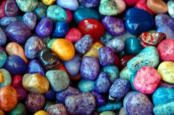 Macro shot of multicolored pebble stones, colorful rocks, background