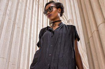 Woman wearing black short-sleeved dress wallpaper