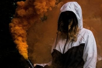 Wallpaper: Woman holding smoke screen bottle