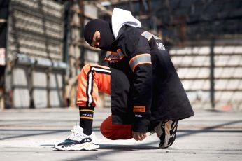 Man sitting on floor wearing black jacket wallpaper