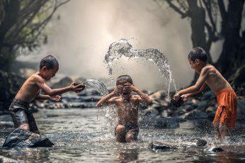 Wallpaper Kids Playing With Water, Boy's Orange Shorts