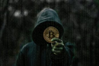Wallpaper Person Showing Round Gold Colored Bitcoin Coin