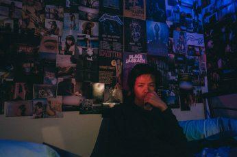 Wallpaper Man Taking Selfie Inside Dark Room With Posters